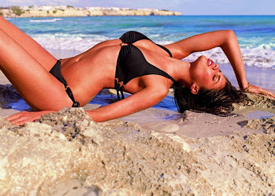 Sara Sampaio sexy mix of killer cleavage for Calzedonia swimwear shoot for the new 2013 collection