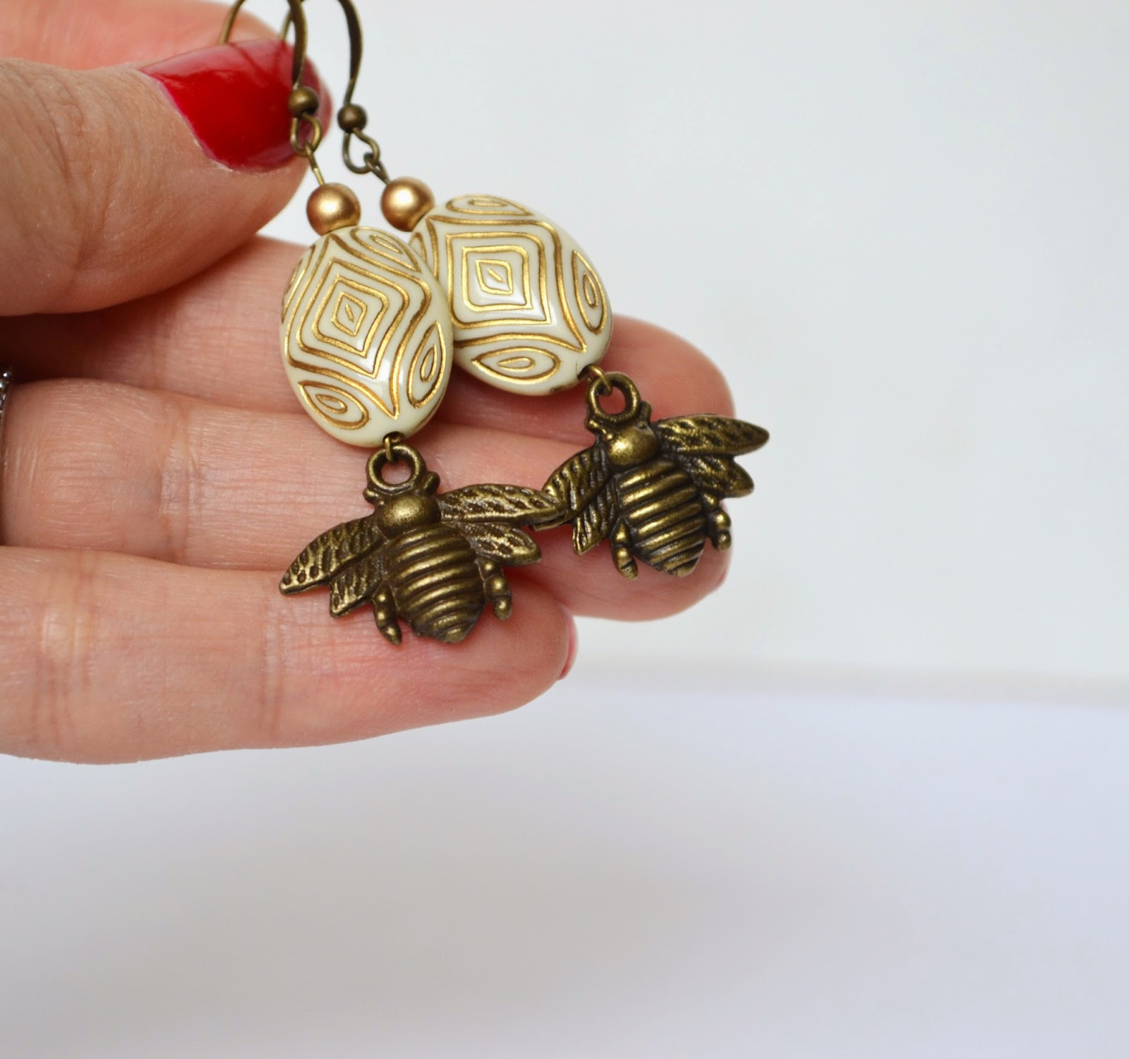 https://www.etsy.com/listing/75885541/bee-earrings-honey-bee-jewelry-bees?ref=shop_home_active_22