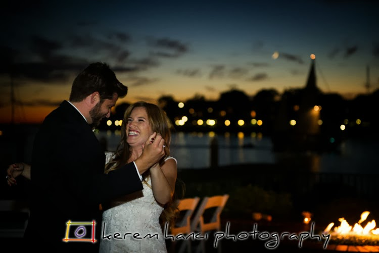 The couple having their first dance as husband and wife with the setting sun's gorgeous sky provides the backdrop on a lovely California night at Marina Del Rey's Shangai Red's