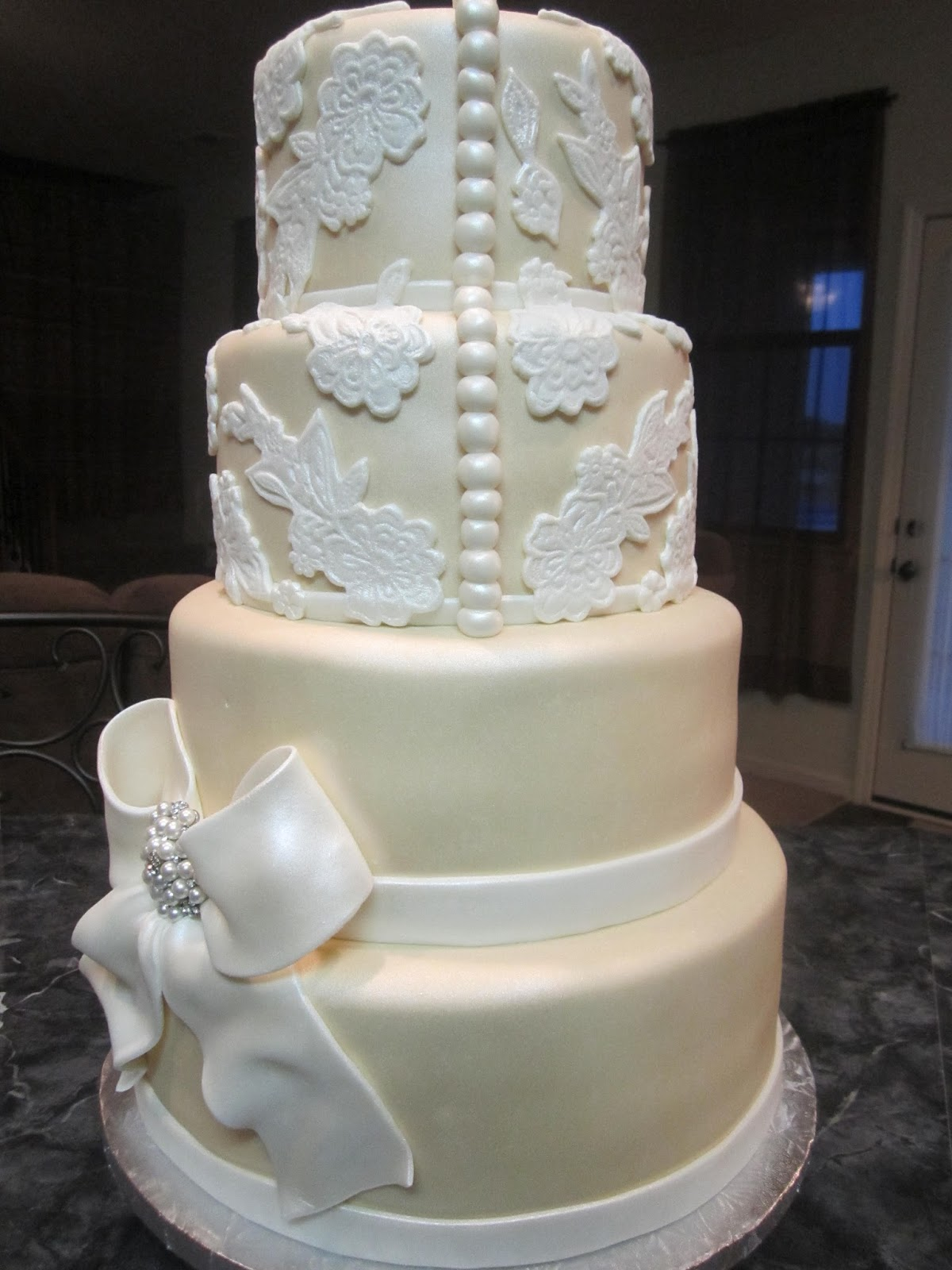 MyMoniCakes Elegant Beige Wedding Cake With Lace Accents And Bow