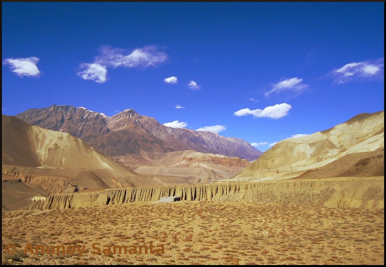 Fleecy Clouds over barren Himalayan land