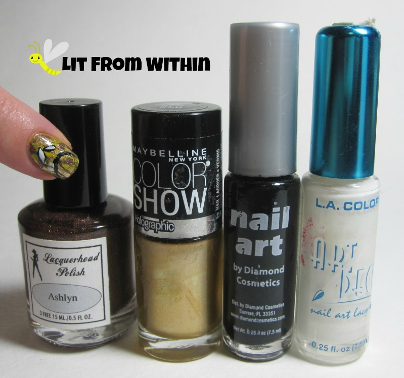 Bottle shot:  Lacquerhead Polish Ashlyn, Maybelline Bold Gold, and nail art stripers in black and white.