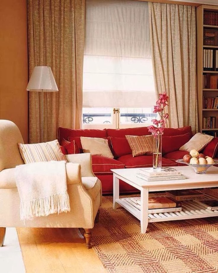 Is well illustrated here with this large red sofa with beige chair