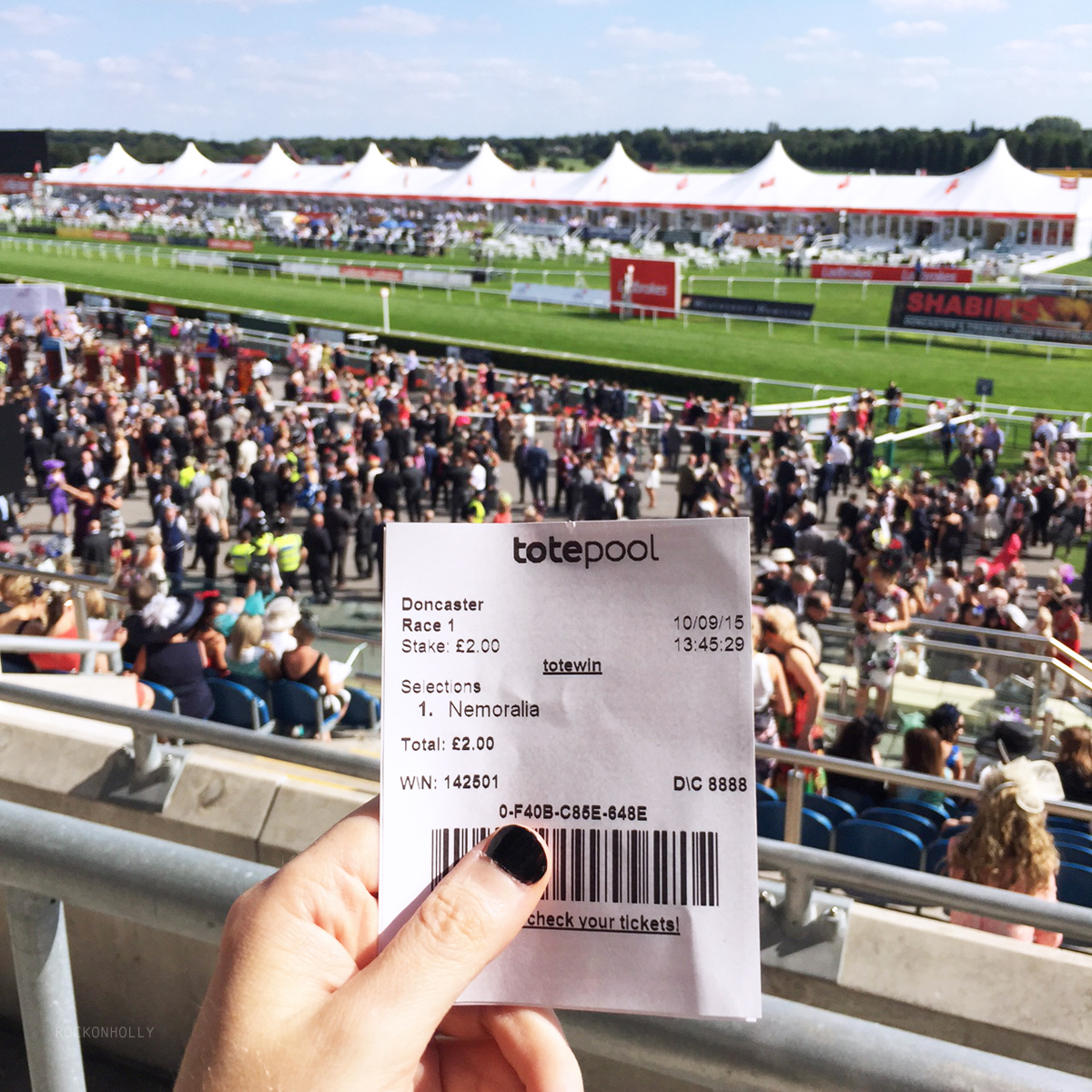 Placing a bet at Ladbrokes Ladies Day at the Races - Doncaster