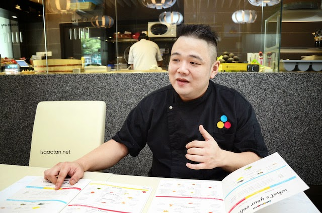 The very cool chef at Okonomi Japanese restaurant explaining his menu to us