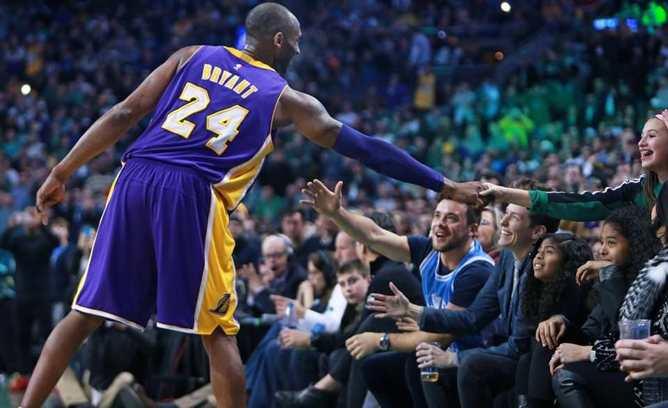 Fans reached out to Kobe Bryant as he went over to say hello to his family late in the fourth quarter