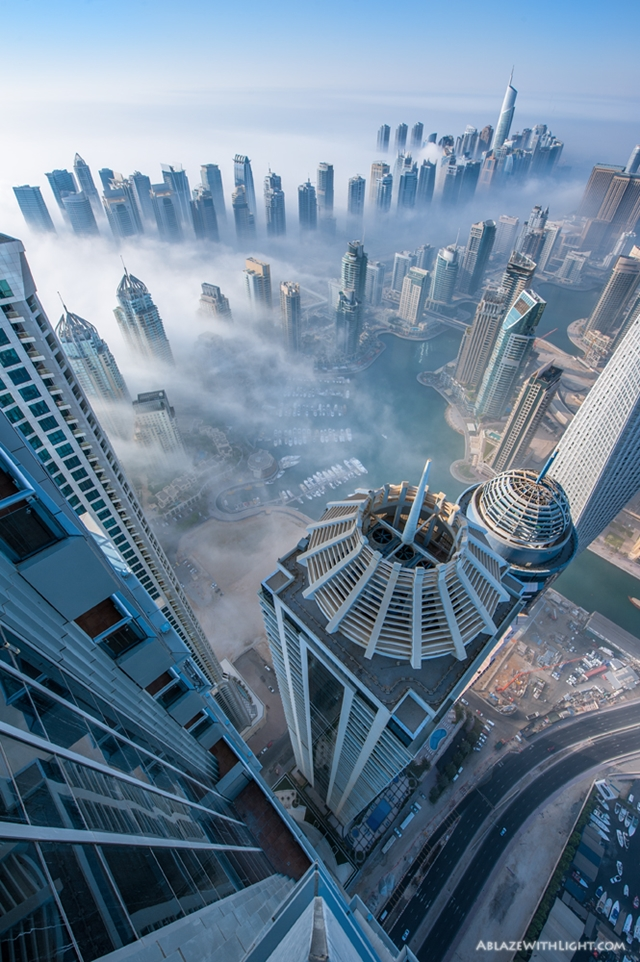 Photo of Dubai Marina skyscrapers getting hit by a fog as seen from the top of the building