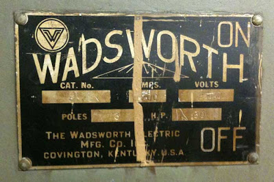 Wadsworth brass and black letters on a metal door