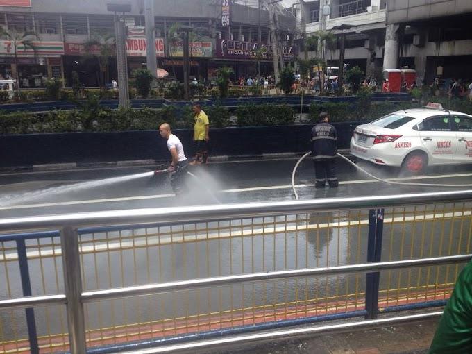 Mandaluyong Firemen Clean Up After INC Rally