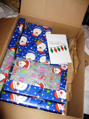 A box of wrapped presents and a card