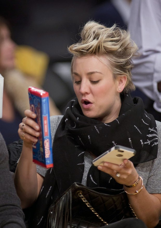 Kaley Cuoco Multitasking at basketball game