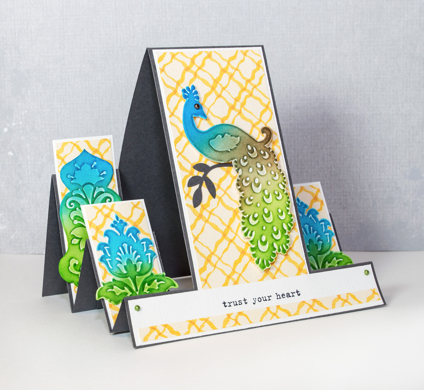 Tri step card with embossed embellishments