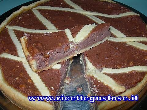 http://www.ricettegustose.it/Crostate_html/Crostata_ricotta_nutella_nocciole.html