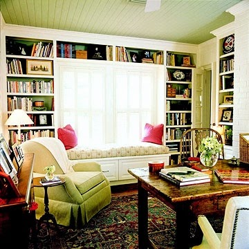 window seat surrounded by bookshelves