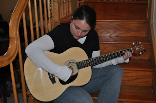 playing guitar, rocking, acoustic guitar