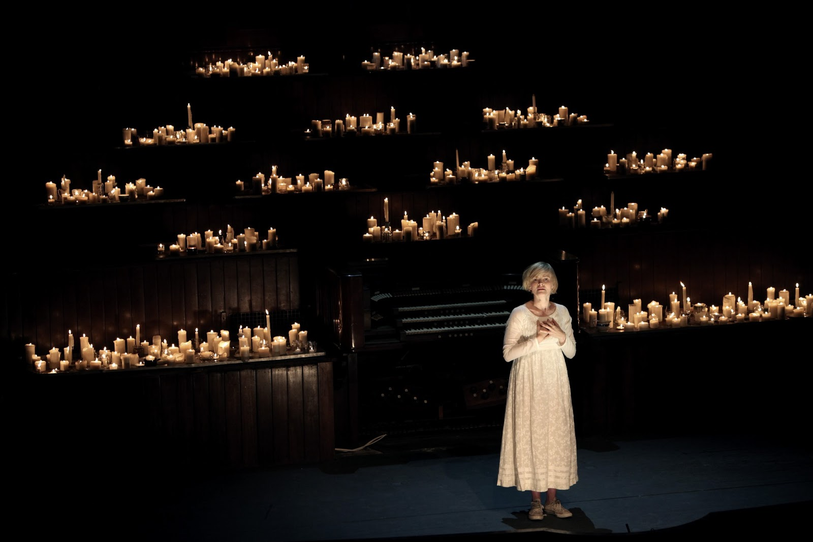 now then manchester the masque of anarchy albert hall  maxine peake takes the stage carrying a night light and places it in front of a thousand candles which form the main part of the stage lighting