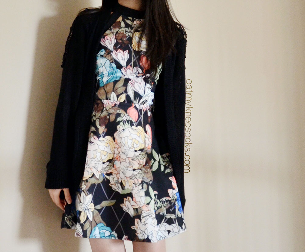 You can wear the SheInside black floral/grid-print skater dress on its own or with a knit cardigan.