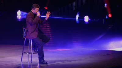George Michael singing on a stool. London, 2008.