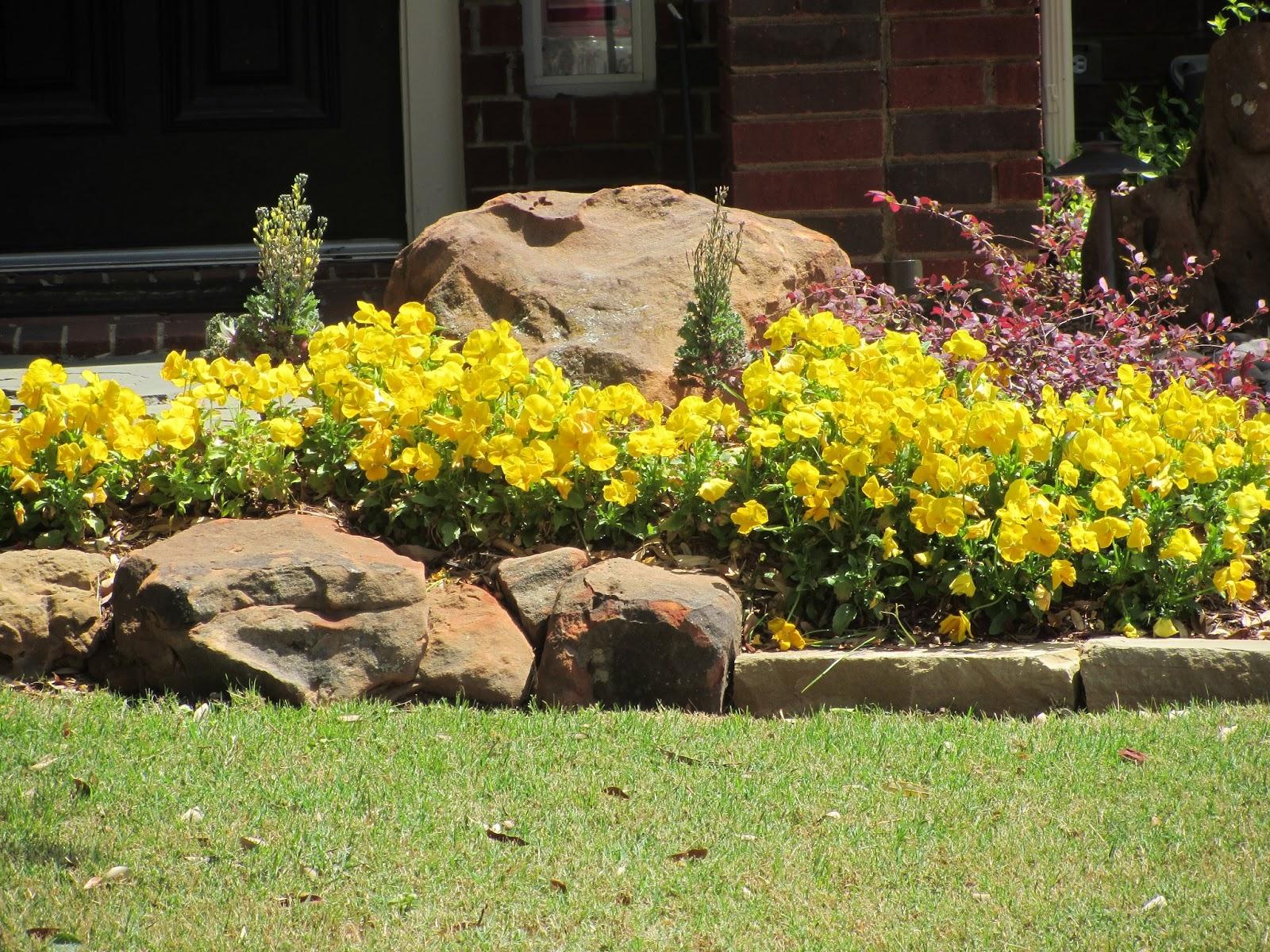 At rivercrest cottage rocks in your beds for Rock flower bed ideas