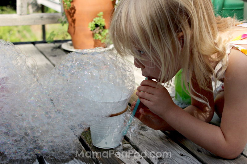 Blowing lots of bubbles at once with your homemade bubble machine!
