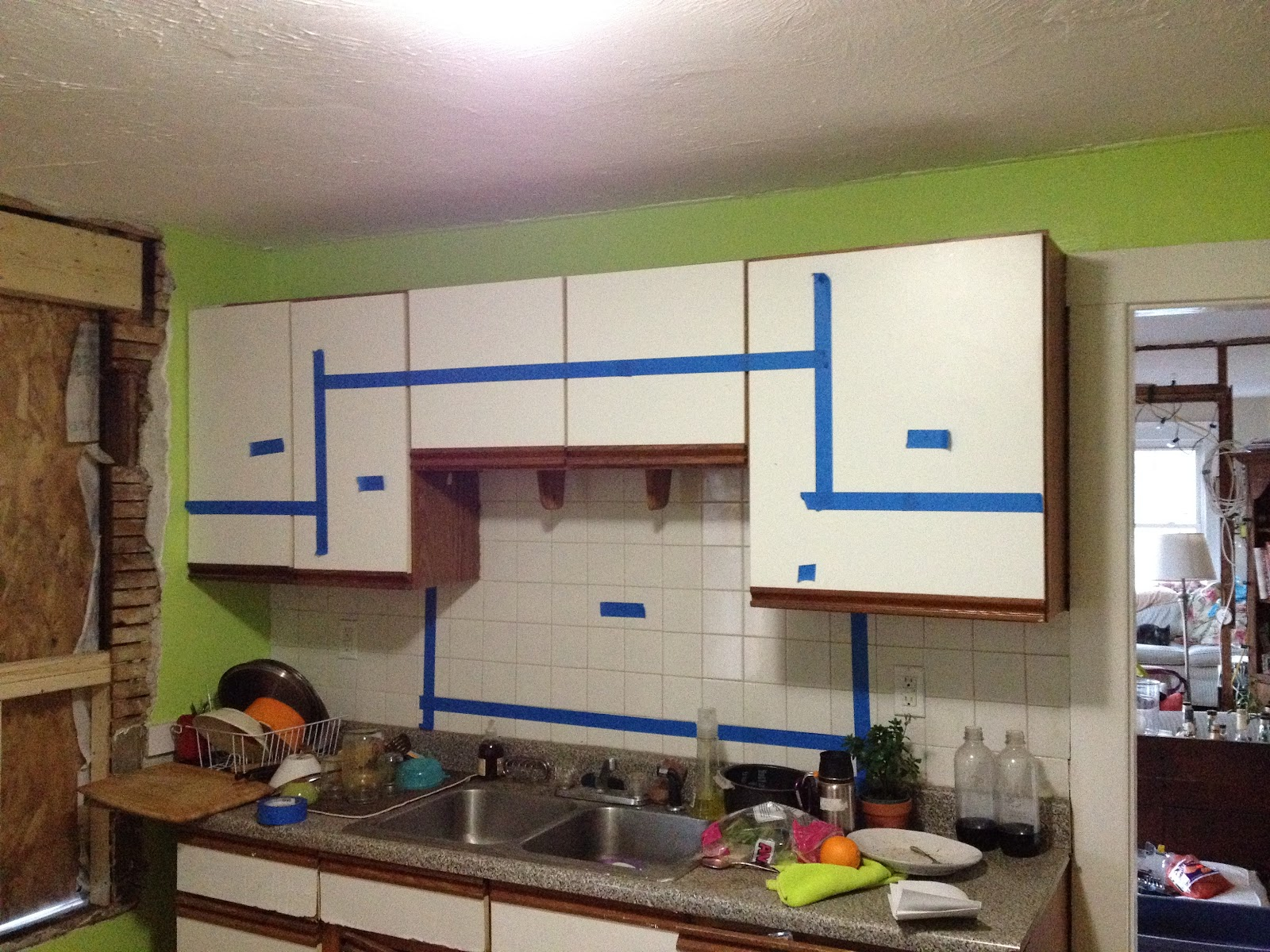 looking at possible kitchen cabinet and wall opening design