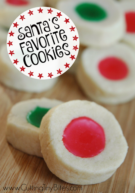 Christmas Thumbprint Cookies in bright red and green. Perfect little melt-in-your-mouth buttery shortbread thumbprint cookie for the holidays. Just the right pop of sweet frosting.