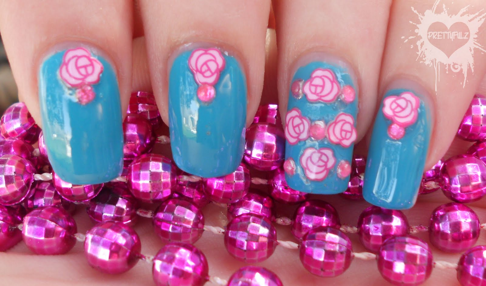 Pretty pink teal flower nail art design