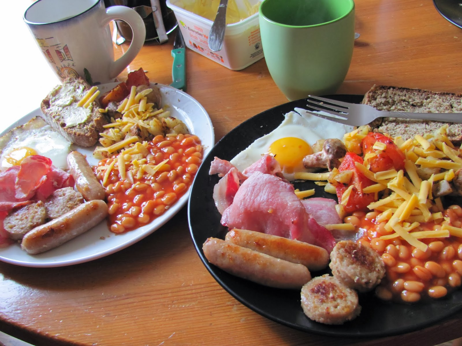 Two plates of Full Irish Breakfast with coffee