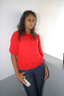 Sonia Deepthi in red T Shirt and Denim Jeans trendy Pictures