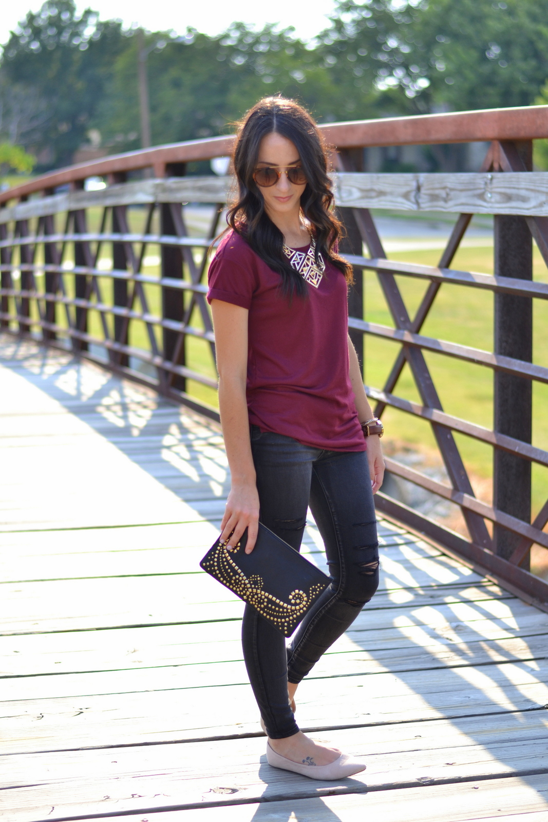 Ripped Black Jeans and Basic Tee for transitional look