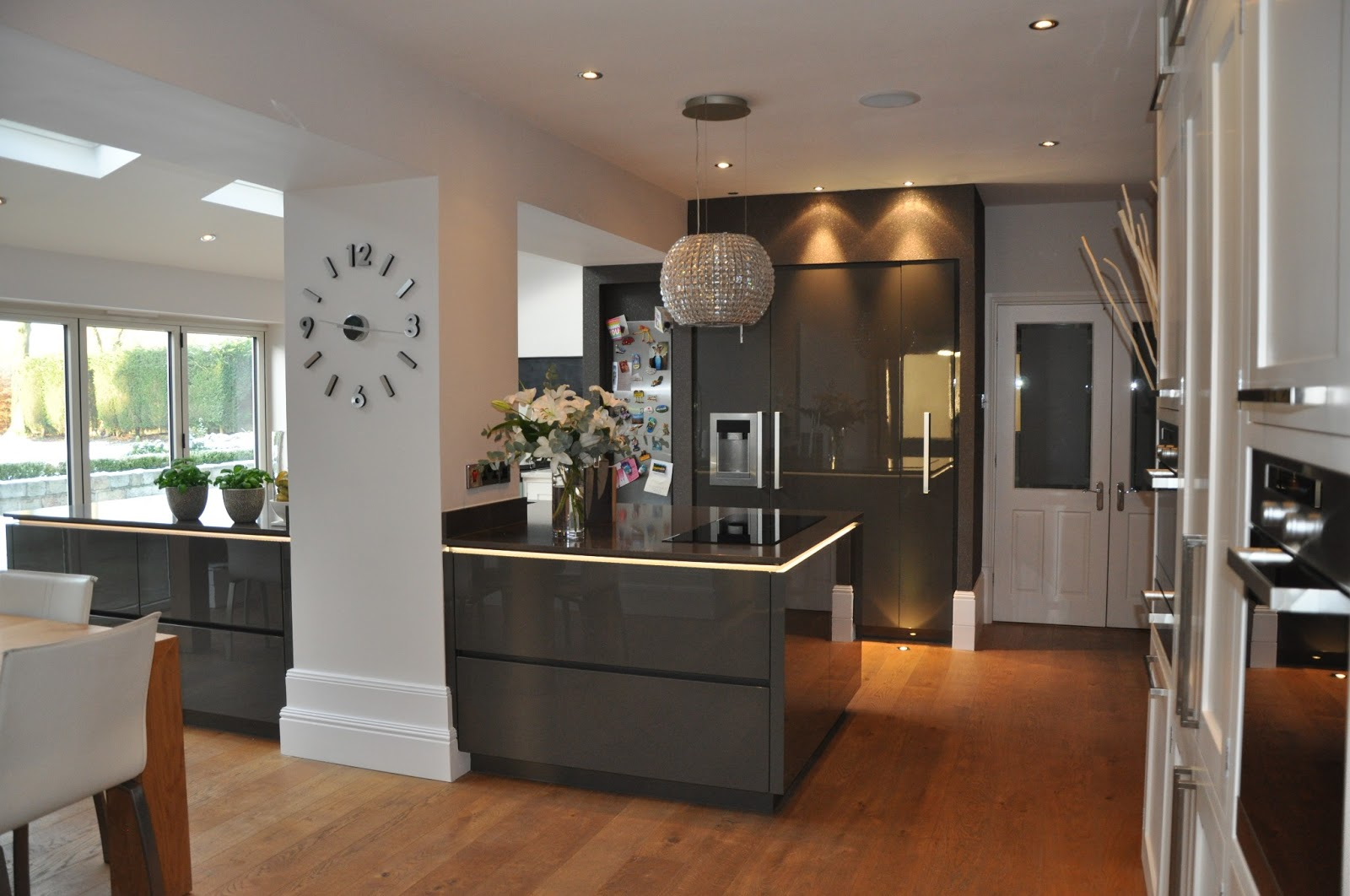 White Kitchen Cabinets and Dark Grey Walls