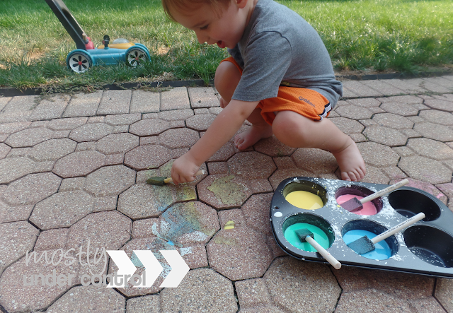 child painting on deck with diy chalk paint