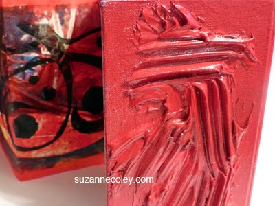Textured red cover by Suzanne Coley