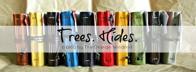 blog header of colorful rainbow of handmade leather journals