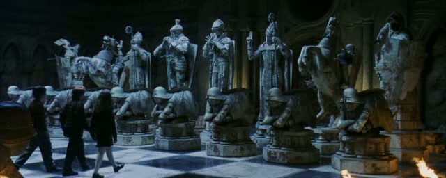 they arrived at a giant chessboard with lifesized pieces ron an expert at chess directed a game with the three of them taking the place of