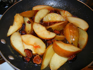 Pears and figs cooking in sauce
