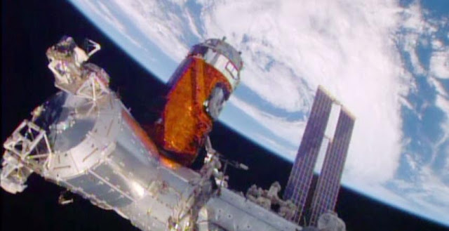 "Japan's ""Kounotori"" resupply ship is installed to the Harmony module. Credit: NASA TV"