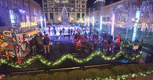 holiday square in downtown louisville with people ice skating and many christmas lights all around the area