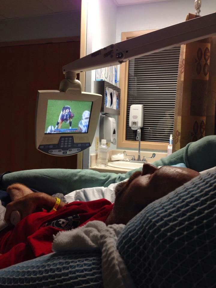 Bill is watching his favorite team and his second favorite football player. (Our baby boy trumps JJ