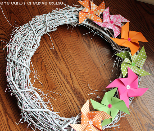 grapevine wreath, scrapbook paper, supplies needed to make summer pinwheel wreath