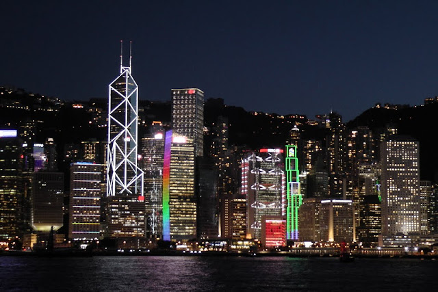 Beautiful lights lit up on skyscrapers along Victoria Harbour in Hong Kong