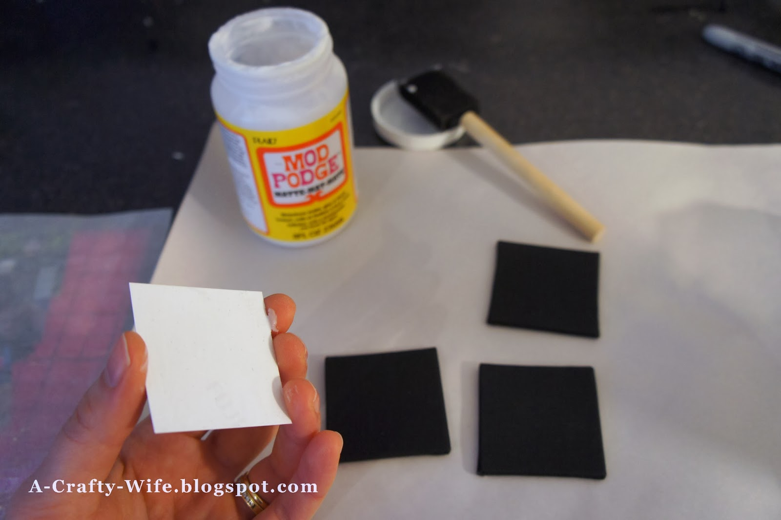 Use Mod Podge to glue photos to canvas for photo magnets  | A Crafty Wife