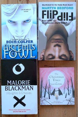 Covers for Artemis Fowl by Eoin Colfer, Noughts & Crosses by Malorie Blackman, The Christmas Truce by Carol Ann Duffy and Flip by Martyn Bedford