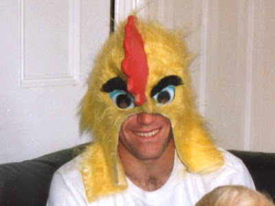 Bruce wearing a chicken head mask