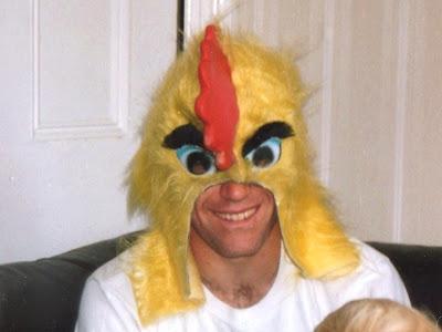 Bruce wearing a chicken head mask