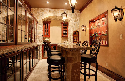 warm scheme of wine cellar that boasts european style with its classic finish and stone wall