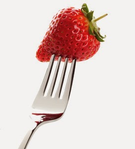Strawberry impaled on a fork