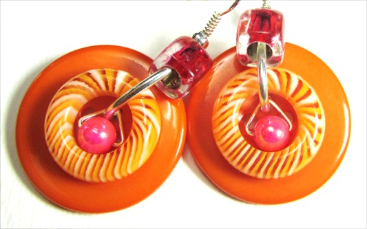 Cool drop dangle earrings have swirl donut beads and accent beads combined with big fashion buttons