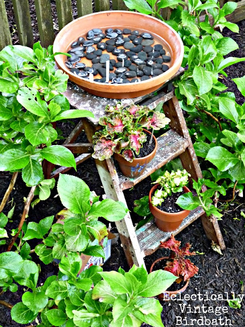 Stepladder terra cotta pot birdbath by Eclectically Vintage via Funky Junk Interiors