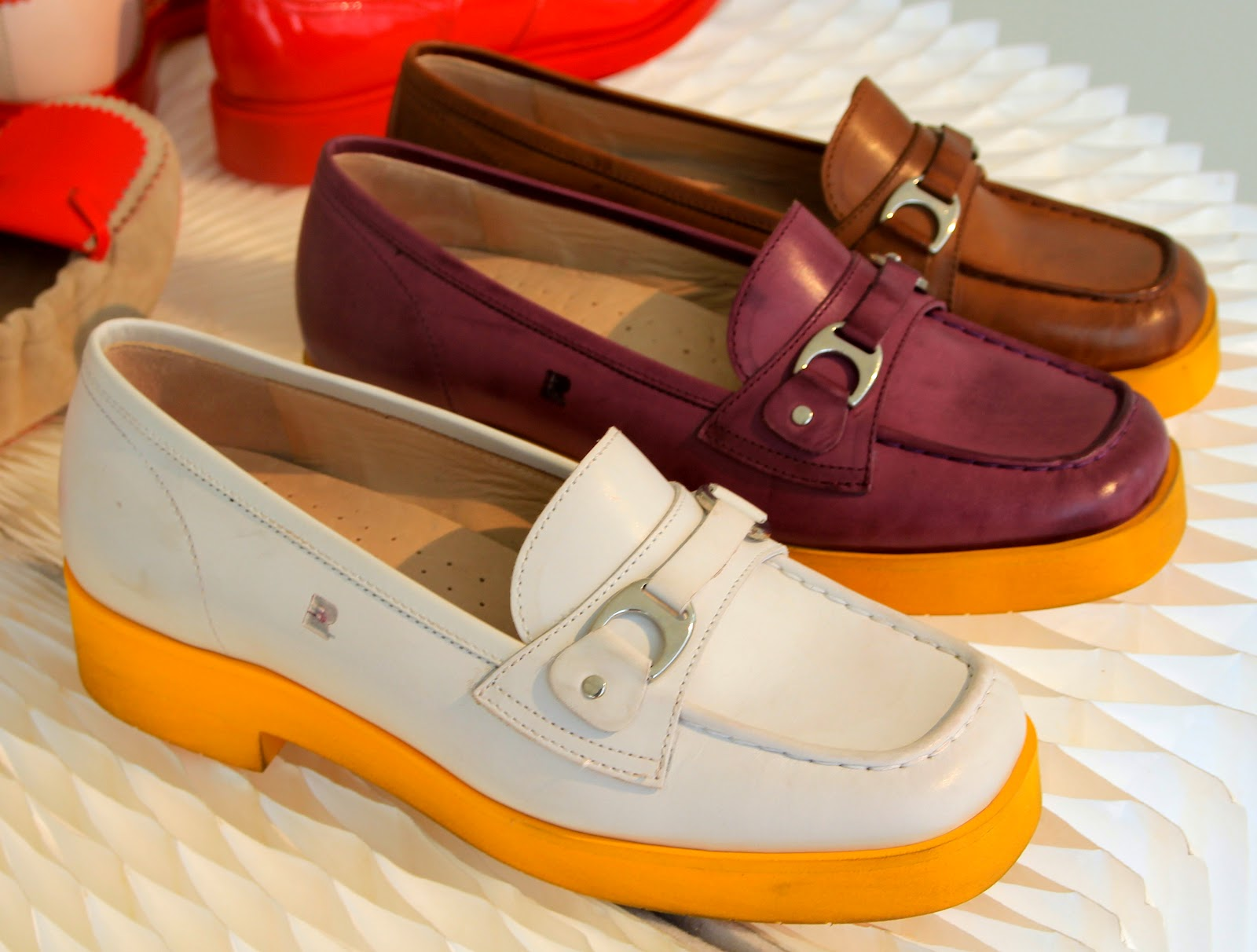 a pop of yellow outsoles....equestrian buckles....comfy insoles---a slip-on  one can wear all day